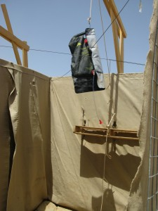 The bag shower system at Patrol Base Yazzie, Afghanistan, requires some set-up.  Dan Lamothe//Staff